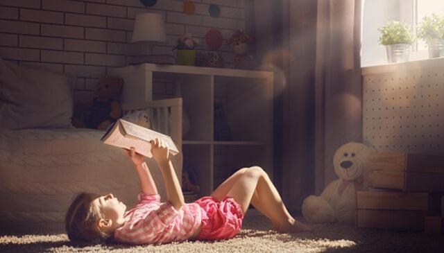 Girl Enjoying a Delightful Book